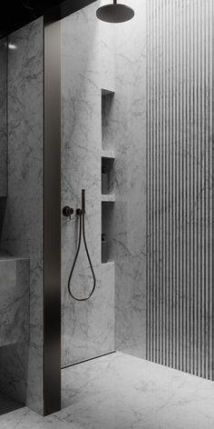 Wenn Naturstein gerillt wird, wirkt er gleich weniger opulent, dafür moderner. Super Nischen in der Wand.