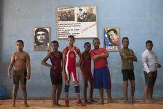 Children make a line during a wrestling training session on the outskirts of Havana, November 1, 2014. REUTERS/Alexandre Meneghini