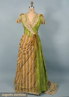 1885 Evening Dress  2 piece, bodice & asymmetrical skirt of pea green silk foulard printed w/ white Art Nouveau arabesques, bustle skirt of mustard silk ribbon alternating w/ bands of Val lace.