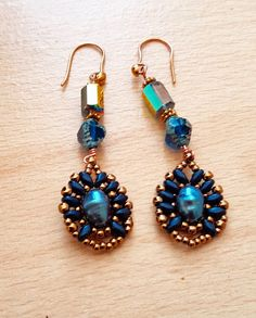 Hey, I found this really awesome Etsy listing at https://www.etsy.com/uk/listing/478675582/bead-woven-earring-cultured-pearl