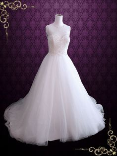Sleeveless Ball Gown Wedding Dress with Pearls. Ask if the pearls can be customized to trickle down the dress giving the illusion of a drop waist.