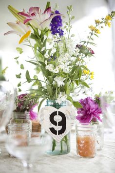 They the mason jar candles  (using wax from old candles bought on freecycle) on every table. They also made the table runners and table numbers with wooden hearts and an old copy of Romeo and Juliet.