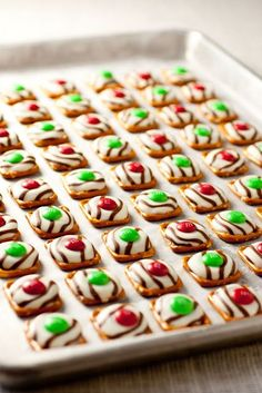 Pretzel M&M cookies, this snack is a must in my house for the holiday time. They melt in your mouth and saltiness plays of off the sweet chocolate and m&m's. There are so many variations to this recipe. For example, we used mint m&m's with normal kisses and round pretzels. The possibilities are endless!