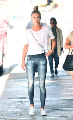 Radiance: Nina Agdal was back in NYC on Tuesday, after enjoying an idyllic beach break, sh...