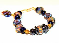 Hey, I found this really awesome Etsy listing at https://www.etsy.com/listing/191213473/purple-gold-glass-bead-bracelet