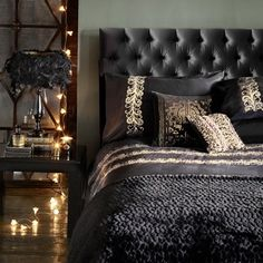 Explore our bedroom design ideas, including this mix of black and gold textiles