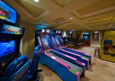 amazing home arcade with skee ball. i am ure my husband would love this in hi dream man cave Skee Ball, Arcade Game Room, Game Room Basement, Basement Ideas, Playroom, Dream Mansion, Game Room Design, Tuscan House, Celebrity Houses