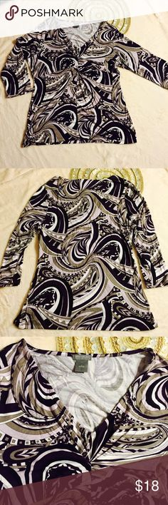 Ann Taylor Womens Sz L, 3/4 Sleeve, Knotted Neck, This is super soft, purples Pucci like printed patter by Ann Taylor in size large. It is knotted, v-neck line and 3/4 sleeve . This top has been gently worn, has no flaws. Kindly look at the photos for all the details.  Fabric content: 94% Rayon 6% Spandex  Measurements in inches: Armpit to armpit: 19 Length (shoulder to hem): 24 Sleeve (inseam): 12  Thank you for looking at my listing ! Ann Taylor Tops Tees - Long Sleeve