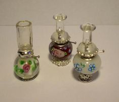 Miniature Oil Lamps - I can't locate a tutorial, but they are made with clear pushpins and beads - I've seen the little metal parts in beads, and the glass rounds/ovals are so pretty - not positive about the chimney on the white with pink flower - this blog is wonderful, very few posts but fantastic ideas!