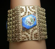 This over the top persian bracelet is a whopping 2 wide and is one of the most fabulous detailed bracelets I have seen with the enamel birds.