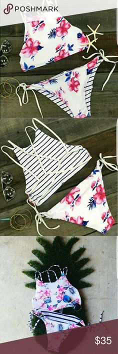 NWT floral bikini New in bag.  The fabric is made of chinlon, and elastane.  Reversible. Adjustable straps on the top and bottoms.  Padded cups inside the top. Swim Bikinis