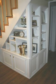Stairwell Built In With Display Shelves And Cabinets Underneath.