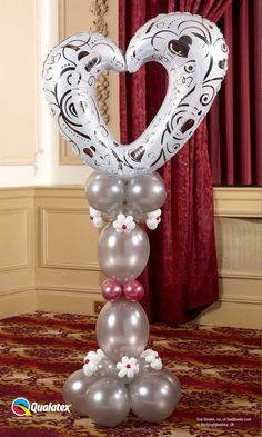 One of my favourite wedding and valentines columns. I simply adore the elegance of the white and silver heart. It also looks beautiful embellished with balloon roses.