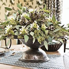 Stems of seeded eucalyptus, silver brunia, and star of Bethlehem make up this centerpiece.