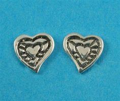 £12.00 incl tax  Sterling silver heart shaped stud earrings.  Approx 8mm long