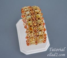 Tenderly Bracelet is fantastic beadwoven bracelet with sparkly Swarovsky crystal bicones and CzechMates 6mm with 2 hole Tile beads. Beading instruction is