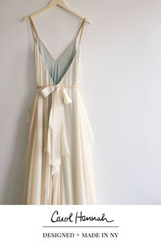 Deep v-neck a-line wedding gown in floaty silk chiffon. Flowy skirt and fun caftan feel, very easy to wear and comfortable. Bridal gown with straps and open back. Long train. Whimsical wedding dress. Wedding ideas for the modern, whimsical, bohemian bride. Nontraditional wedding ideas for ethereal brides' wedding day style. Gold bridal sash with Bow. #weddingdayideas #weddingdressideas #weddingdressstyles #weddingideas