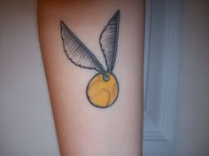 My Golden Snitch Tattoo from Harry Potter. I got it to show my love of Harry Potter as both Harry and Draco played seeker for their house teams.