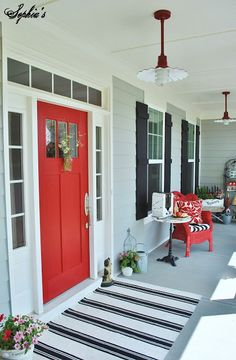 LOVE this Farmhouse Style Front Porch with Pops of Red. So many beautiful pictures of this space @Kristen - Sophia's Decor