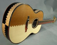 Howard Klepper Son of Dovetail Madness steel string. This one might be even more impressive.