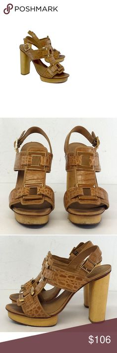 """Tory Burch- Tan Leather Snakeskin Sandal Heels Sz 9 Dress up any plain outfit with the unique texture of these snakeskin embossed sandals ornamented with glossy rings. A wide wooden block heel provides added stability. Size 9 M Adjustable ankle straps Out sole wear Wear on interior/toe impressions Platform height 5"""" Heel height 1"""" Bohemian, preppy, hippy, young, & luxe are all words to describethis designer's style. Tory Burch has a signature style but also keeps up with new trends and…"""