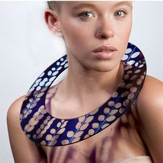 SUE GREGOR, UK - Shadow necklace in acrylic, inspired by the wedding disk necklaces worn by Masai women.