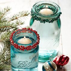 Any holiday bracelets hiding in your stash? Bust them out to wrap around Mason jar rims for the cutest candleholders you've ever seen. Fill each with water, then top with tea lights. Ahh, easy ambiance and Christmas decor. Handmade Christmas Crafts, Mason Jar Christmas Crafts, Diy Christmas Decorations Easy, 3d Christmas, Holiday Centerpieces, Jar Crafts, Simple Christmas, All Things Christmas, Holiday Crafts