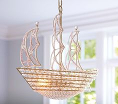 Light up your nursery with this Pottery Barn Kids crystal ship chandelier. #pink #baby #nursery