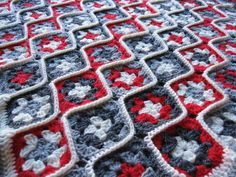 Crochet Granny Square Design Uses the joining of motifs as a design element by breaking up the typical square layout with wavy ridges. Joining Granny Squares, Crochet Squares Afghan, Crochet Blocks, Granny Square Crochet Pattern, Crochet Stitches Patterns, Crochet Granny, Crochet Motif, Knit Crochet, Crochet Afghans