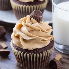 A chocolate cupcake with peanut butter icing with a glass of milk is the perfect dessert if you love chocolate and peanut butter.