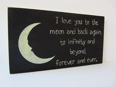 "Hand Painted Wooden Black Primitive Sign, ""I love you to the moon and back again, to infinity and beyond, forever and ever."". $15.00, via Etsy."