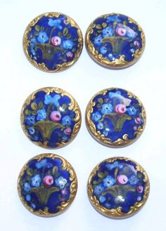 Antique gilded hand enameled painted blue floral buttons.