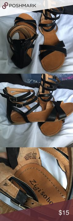 Black gladiators SZ9 Black and tan gladiators; light wear on them. Adjustable at the ankle and they close in the back with a zipper. Zigi Soho Shoes Sandals