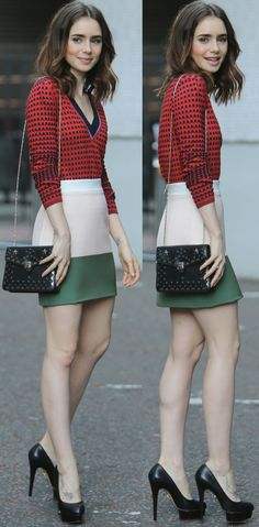"""Lily Collins wearing a red patterned top, By Johnny color block skirt, and Charlotte Olympia """"Dolly"""" pumps at the ITV studios in London"""