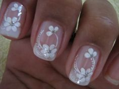 Simple french manicure with the design on just one finger, ring finger most likely :)