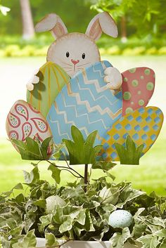 Painted in happy colors and highlighted with glitter, Pier 1's Rabbit with Eggs Yard Stake is sure to brighten your garden.