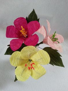 Learn how to make this easy hibiscus flower using crepe paper streamers.  You can get these streamers at the dollar stores or craft stores.  They are very inexpensive.  The instructions are simple and you only need a few supplies to get started.  These flowers are great for home and party decorations.     Materials   	crepe paper streamers 	soft wire 	flower pistils 	scissors 	glue
