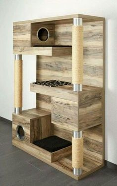 The Catframe combines a contemporary wood cat tree, sisal rope scratching posts, cubby holes, soft pads for kneading and sleeping, and last but certainly not least – storage for all kitties toys and treats.