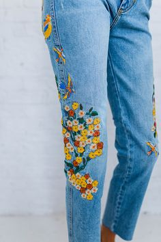 "DETAILS: With beautiful and colorful embroidery down the sides, these high-rise jeans are in a girlfriend fit. - Authentic, comfort stretch fabrication - Raw hem - Five-pocket style - Button closure and zip fly - Fabric Content: 98% Cotton, 2% Elastane - Machine Wash Cold - Import MEASUREMENTS: - Waist: 24=26"", 25=27"", 26=28"", 27=29"", 28=30"", 29=31"", 30=32"", 31=33"" - Hips: 24=32"", 25=33"", 26=34"", 27=35"", 28=36"", 29=37"", 30=38"", 31=39"" - Rise: 11"" - Inseam: 27"""