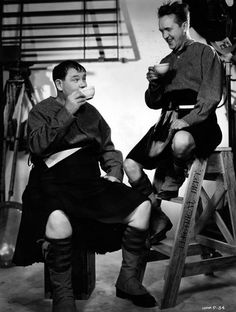 Oliver Hardy and Stan Laurel share a cup of coffee on the set of Bonnie Scotland 1935...