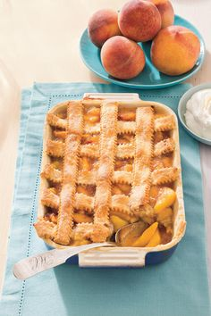 Pecan-Peach Cobbler - Old-Fashioned Pies and Cobblers - Southernliving. Recipe: Pecan-Peach Cobbler Showcase two of the South's most beloved products—peaches and pecans—in this old-fashioned peach cobbler recipe. Pecan Cobbler, Fruit Cobbler, Soul Food Peach Cobbler Recipe, Köstliche Desserts, Delicious Desserts, Dessert Recipes, Grilled Desserts, Drink Recipes, Good Food