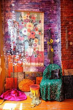 Love the tapestry, beaded chandelier, lighted tree branches, and assortment of bright jewel-toned fabrics and textures against the exposed brick wall! A pretty, colorful bedroom nook.