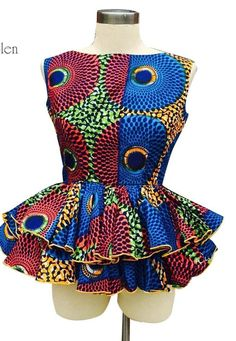 Handmade African Print Ankara Peplum top in a variety of fabric. It can be worn casually or dressed up to give an African elegance. African American Fashion, Latest African Fashion Dresses, African Print Dresses, African Print Fashion, Africa Fashion, African Dresses Plus Size, Ankara Fashion, African Prints, African Attire