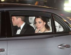 Poignant: The Royals were seen leaving the premiere after hearing the news of Mandela's death. Prince William had told reporters: 'I just wa...