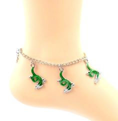Green Dragon/ Serpent Anklet - Silver-tone/Pewter Ankle Bracelet- Sizes 8-11. These interesting enamel green dragon/serpent charms hang from a pewter/platinum-tone chain with matching lobster claw clasp . It is bold, feminine and sexy all at the same time. It is available in sizes 8-11, please utilize customization for size choice. To determine proper size measure ankle just below ankle bone and add 1/2 inch. Your anklet will arrive in a lovely gift box.