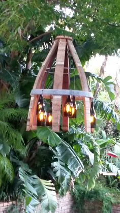 Outdoor tree chandelier made of old wine barrel staves and carbon graphite filament bulbs in cut wine bottles Wine Barrel Crafts, Wine Barrel Rings, Cutting Wine Bottles, Wine Bottle Corks, Wine Barrel Chandelier, Branch Chandelier, I Like Lamp, Wine Images, Wine Barrel Furniture