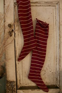 christmas stockings hung on a cupboard - Primitive Christmas Stockings