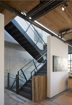 a skylight tops the stairwell to bring daylight into the studio and down to the entrance…