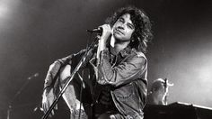 Michael Hutchence with his ankle in plaster performs with INXS at the Hordern Pavilion on 27 October, 1994.