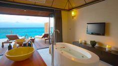 Deluxe water villa interior at Lily beach resort Maldives #voyagewave #themaldives → www.voyagewave.com